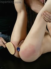 Suspended and spanked slut