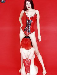 Two lesbians are worn in red latex