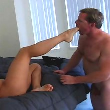 A slaveboy getting his cock wanked by her pretty feet