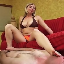 Blonde dominatrix sat on slave and dominated him by feet