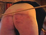 Strict teacher paddling and caning bad girl