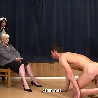 This young lad is humiliated by three women