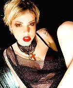 Glamour blonde in seethru slip and black panties