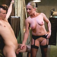 Bad ass dominatrix hobbles dogboy and reams him in the ass with her fist!