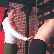 Guy gets a bare ass paddling bent over in the exercise room from strict bitch