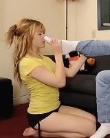 A submissive blonde slavegirl licks feet