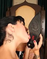 A tattoed slavegirl licked boots
