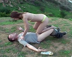 Chick tormented malesub` cock and balls outdoor