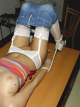 Blonde babe was tied on the table
