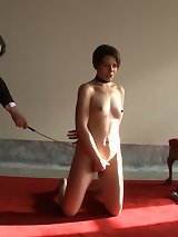 Slave girl strips and prepares to service kinky Masters and Mistresses