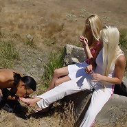 The slaveboy kissed toes outdoor