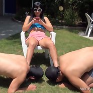Two slaves worship domina`s feet outdoor