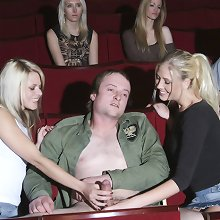 Two blondes strip and wank a lucky guy in a cinema full of girls