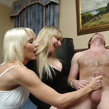All three women playing with his cock