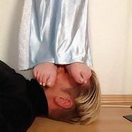 Blonde standing on male`s head