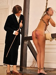 A strong caning for a young Lady