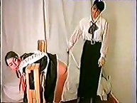School mistress spanked submissives