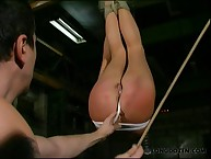 Suspended sweetheart getting ass caned