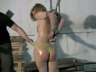 Gagged oiled blonde wants whipping