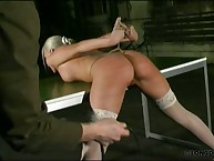 Blonde's painful bondage and whipping