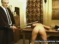 Headmasters disciplining schoolgirl with spanking