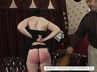Salacious flapper gets stern spanks on her prat