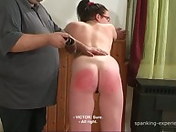 Attractive babe gets her rump flogged